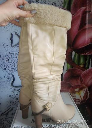 Зимние кожаные высокие сапоги с металлическишми шпорами