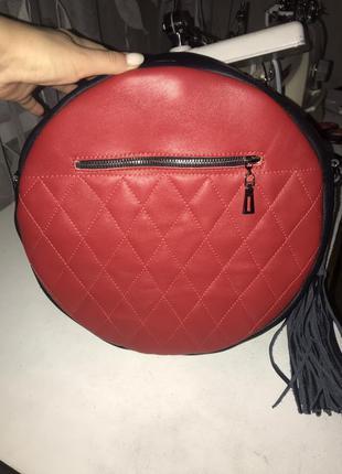 Круглый сумка-рюкзак из натуральной кожи