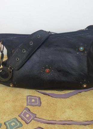 Кожаная сумка с оригинальной ручкой