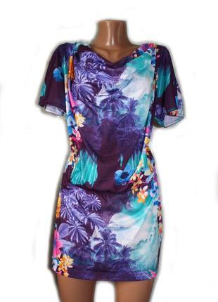 Блуза туника фиолетовая в принт цветов и пальм с вшитой в пояс...
