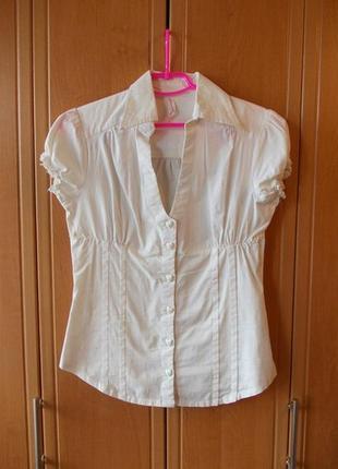 Белая рубашка с пуговками-сердечками от terranova