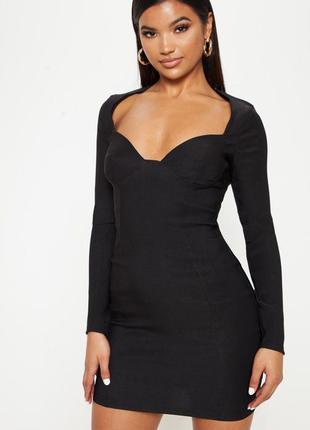 Черное эластичное платье мини с длинными рукавами и красивым д...