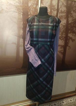 Сарафан в клектку и блузка-сетка лавандового цвета.
