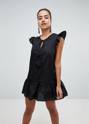 Стильное  черное платье с оборками рюшами кисточками бренда pr...