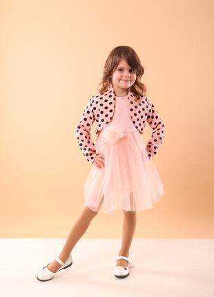 Нарядное платье с коротким рукавом и с двойной юбкой из фатина.