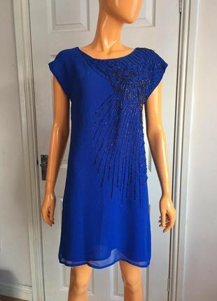 Шифоновое короткое платье расшитое стеклярусом с открытой спин...