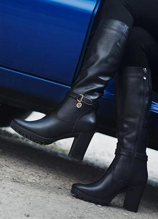 Женские зимние сапоги на каблуке