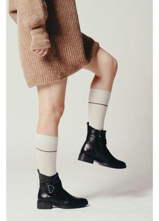 Зимние женские сапоги на невысоком каблуке