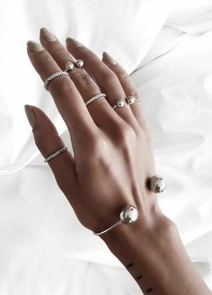 Набор украшений браслет и кольца на фаланги пальцев серебристы...