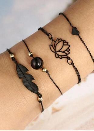 Набор браслетов 4 штуки черного цвета ( подвески сердце, цвето...
