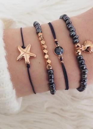 Набор браслетов 4 штуки с подвесками ( ракушка, морская звезда )
