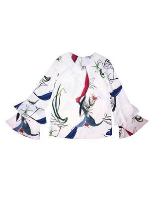 Блузка в цветочный принт с воланами