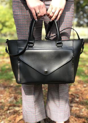 Интересная молодежная сумка черного цвета с двумя видами ручек
