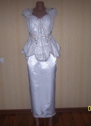 Нарядный красивый костюм на наш размер 48