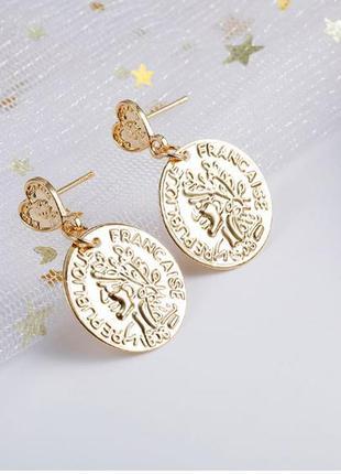 Серьги монетки золотистого цвета