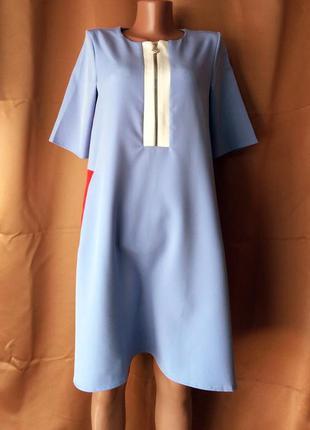 Платье-трапеция с карманами