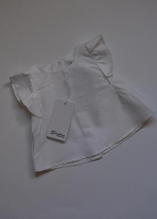 Біла нарядна блуза фірми gaialuna (6-12 місяців)