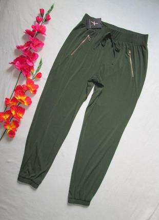 Шикарные стильные модные брюки бананы цвета хаки под резинку в...