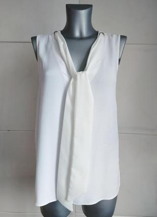 Стильная белая блуза zara с завязками и люверсами