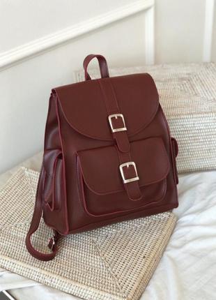 Бордовый рюкзак с карманами и пряжками. рюкзак сумка вишнёвая....