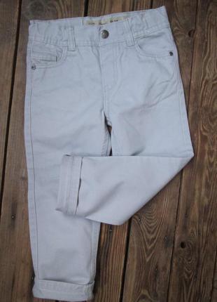 Зауженные джинсы primark denim co на 4-5 лет/ светло-серые брю...