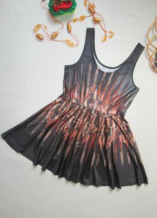 Классное короткое платье солнце-клеш в туземный принт без рука...