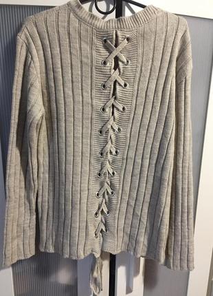 Красивый шерстяной/акриловый  вязаный тёплый свитер со шнуровк...