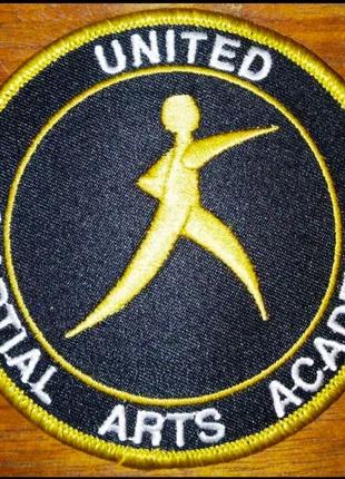 Шеврон United Martial Arts Academy, школа боевых искусств