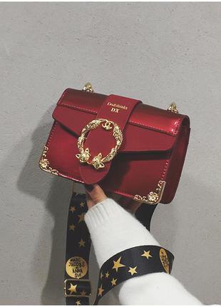 Маленькая женская лаковая сумка марс якобс бордовая