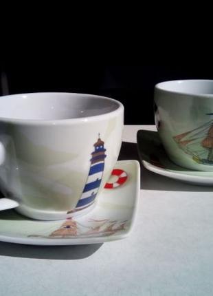 Чашки и блюдца на подставке с морским рисунком