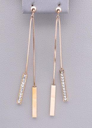 Позолоченные длинные серьги с фианитами