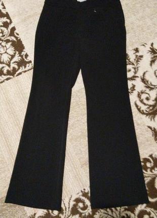 Нарядные новые расклешенные брюки