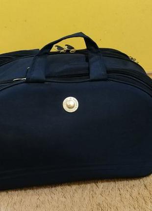 Дорожня сумка на колесах Дорожная сумка чемодан валіза