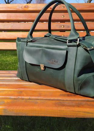 Дорожная кожаная сумка зеленого цвета