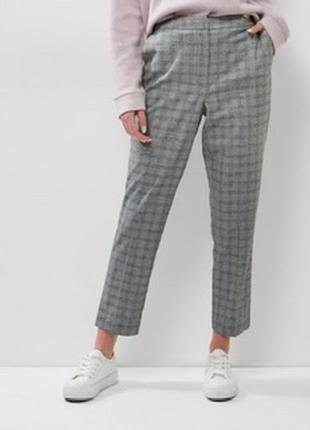 Крутые брюки в клетку новые сток