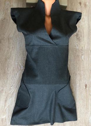 Новое женское платье с карманами.