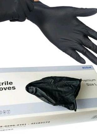 Одноразовые нитриловые перчатки черного цвета 100 шт. в упаковке.