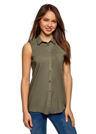 Зеленая однотонная блузка без рукава oodji