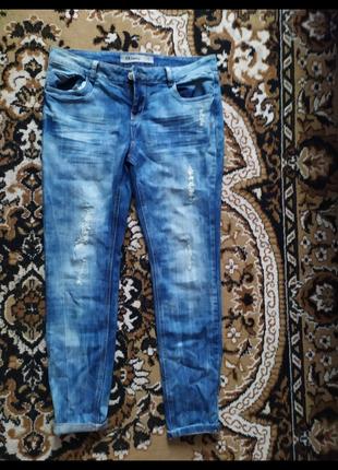 Новые синие джинсы