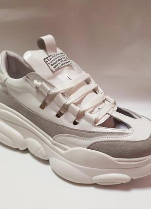 Кожаные кроссовки с вырезами от производителя flamanti 37 р..