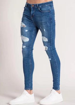 Новые зауженные мужские синие рванные джинсы (с дырками)