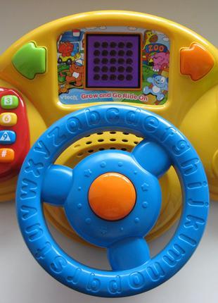 Игровой блок в виде рулевой панели VTech