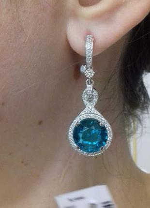 Вечерние серебряные серьги с голубым камнем