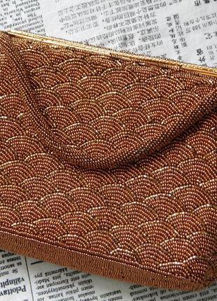 Шикарный клатч из бисера бронзового цвета.