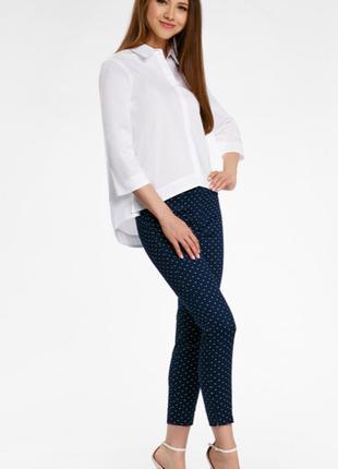 Женские темно-синие брюки в горошек