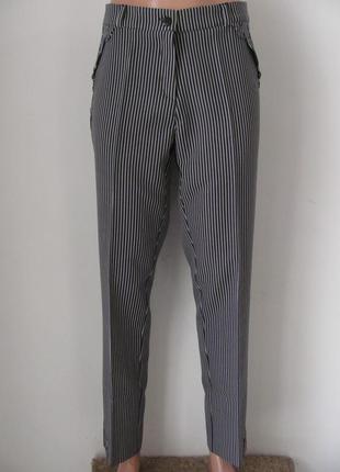 Ультрамодные брюки в полосатый принт позволят выглядеть стильн...