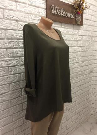 Стильна блуза з подовженою спиною