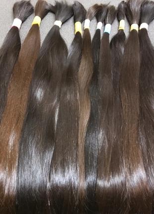 Срез натуральных волос в косе густые и здоровые не окрашенные