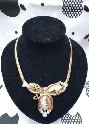 Ожерелье золотистый металл со стразами и вставками серебристый...