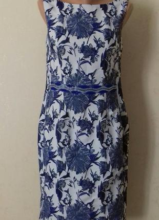 Красивое платье с жаккардовым принтоми вышивкой бисером